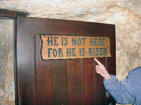 The sign on the door of the empty Garden Tomb.